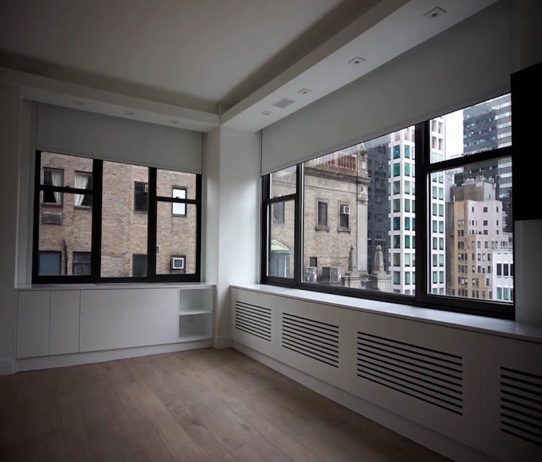 lutron-motorized-shades-office-space-blog-post high rise building treatments/window-treatments-for-office-space